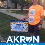 Jim Merklin finds his sign during the run. Way to go raising funds for the Akron Children's Hospital